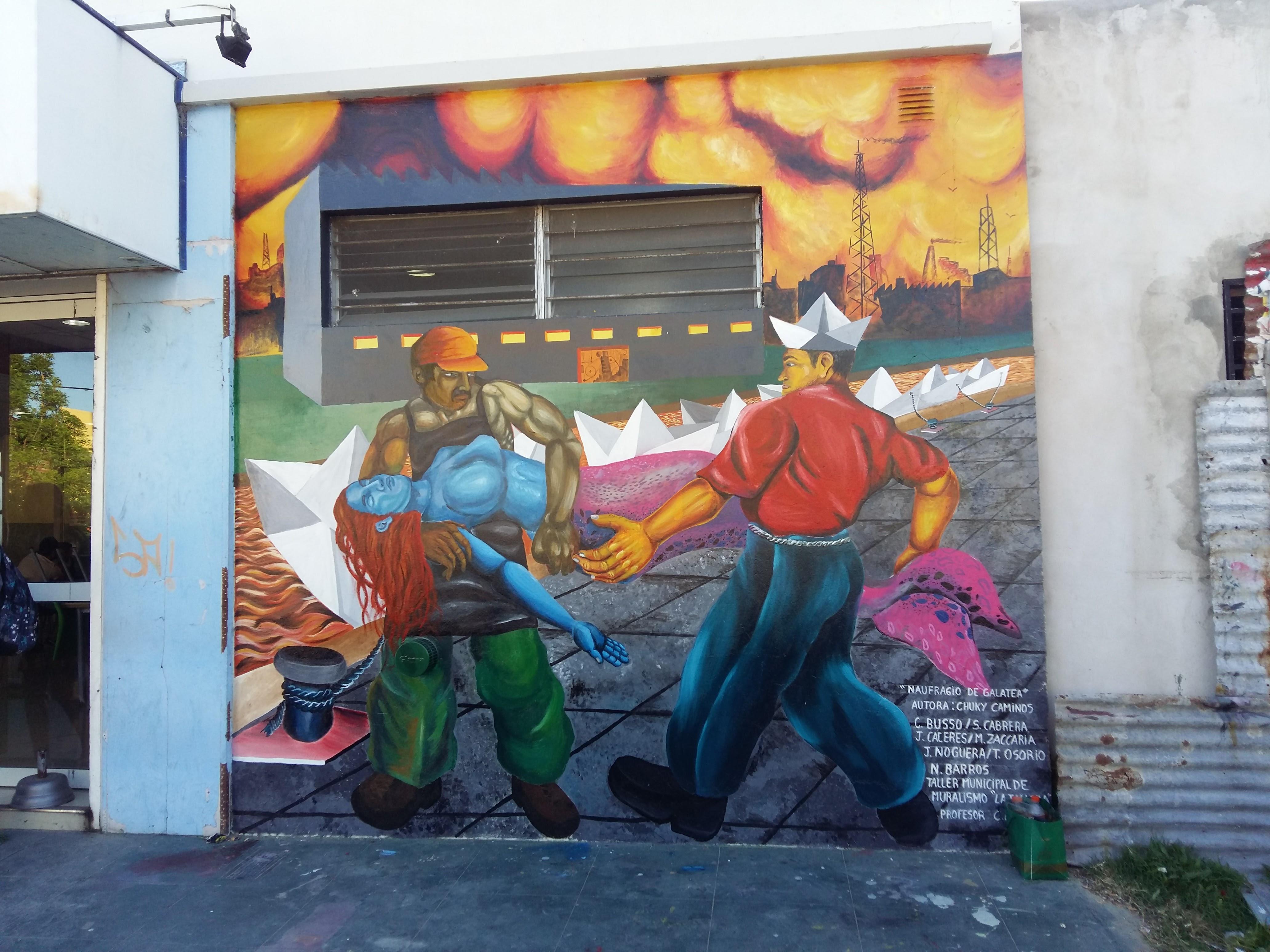"""La Dirección de Cultura de la Municipalidad de Berisso continúa con el trabajo trazado por el taller de muralismo """"La Tallera"""" en un muro de la calle 164 entre 16 y 17, espacio donde se plasmó un nuevo mural de carácter surrealista."""